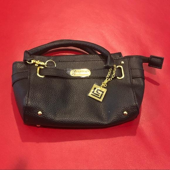 lori grenier Handbags - Lori Grenier black cellphone mini bag - new